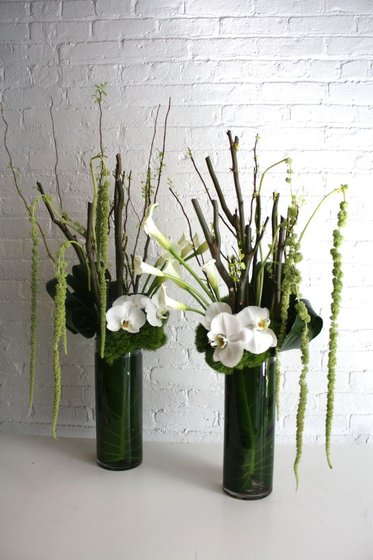 Tall and unique edgy weekly office floral arrangements for a corporate  client. Curly willow branches