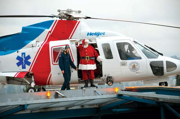Super sleigh: Santa Claus took to the skies in style when he made a special stop at Royal Columbian Hospital on Dec. 13 to visit sick kids and spread some holiday cheer along with some gifts. Helijet and the B.C. Ambulance Service jointly host the program every year at Royal Columbian and Victoria General Hospitals - both of which have heli-pads for helicopters to land on the roof.