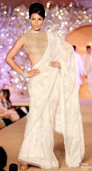 Gold and white sari. Abu Jani and Sandeep Khosla presents The Golden Peacock Collection.