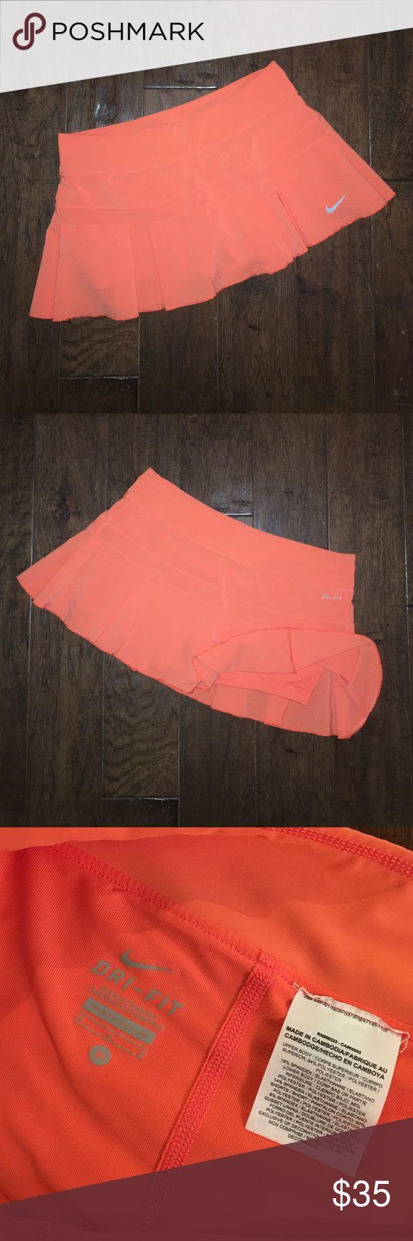 Nike Women's Tennis skort Nike Orange tennis skort with built-in compression shorts. Nike Shorts Skorts