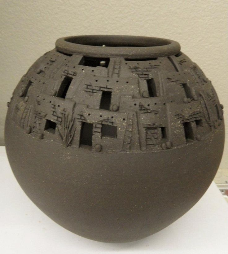 Kriston Mognett Ceramic Studio Artist.  Hand carved pueblo vases. Details include ladders, exposed rock, cacti, & pots.