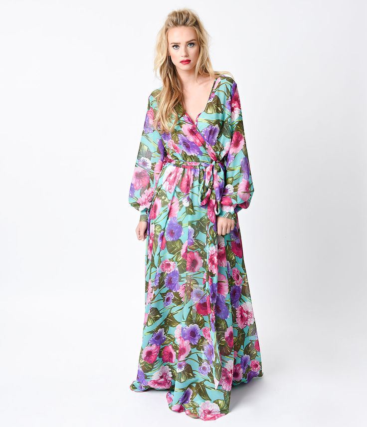 It's far out, fantastic and floor length, dames! A breathtaking seventies inspired maxi dress boasting a deep surplice v-neckline, cuffed long sleeves with darling faceted double button detail and an elasticized waistline for a flexible fit. A lush teal, purple and pink floral print is complemented by a sweeping skirt, attached self tie and glamorously gauzy composition. We'll just be over here on the fainting couch, dear. <br />Available in sizes S-L while supplies last.
