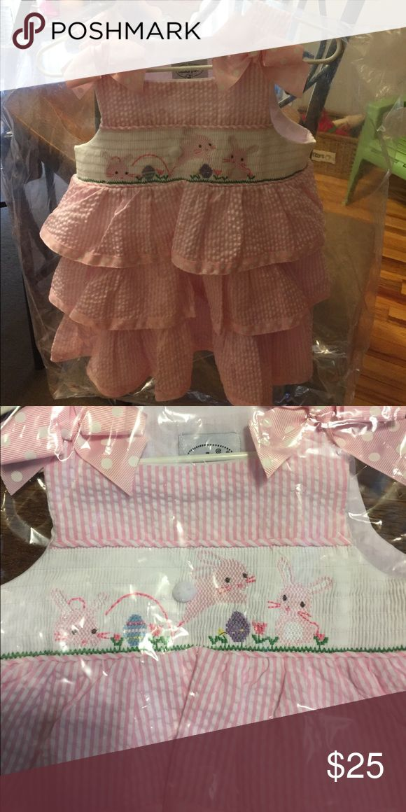 NWT smocked Easter dress Smocked Easter dress by Mud Pie size 12-18 months. In it's original packaging with hanger, tags, and plastic cover. From smoke free home. Price is firm. Mud Pie Dresses