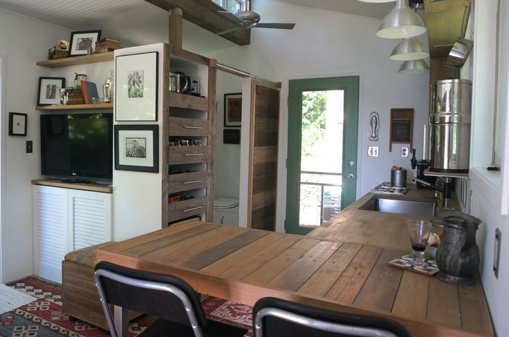 Love the entry right into the kitchen. And the bar doubling as kitchen table and living seating.