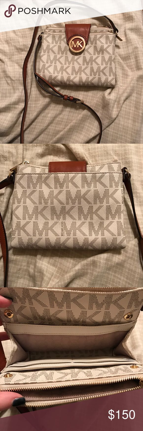 Michael Kors crossbody. Small authentic cross body, in like new condition. Has two zipper pockets, a back pocket, and credit card and money compartments. Retails for $200. Michael Kors Bags Crossbody Bags