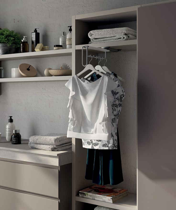 "The pull-out clothes rack which is inserted in one compartment of the ""Fluida"" Wall System is perfect to keep all your clothes tidy and at hand."