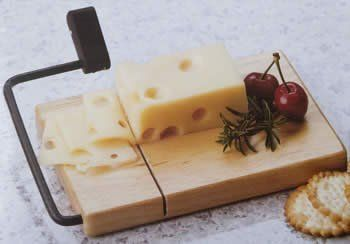 """Natural Utility Beechwood Cheese Slicer by HomeAndWine.com. $11.02. The stainless steel cutting wire sinks easily.. Board dimensions: 7"""" x 4 3/4"""". Lifetime warranty against breakage.. The wire is replaceable. Built-in stylish black arm and handle grip.. It is natural utility beechwood cheese slicer with built-in stylish black arm and handle grip is one of our most popular models. The stainless steel cutting wire sinks easily into even the hardest cheese to guarante..."""