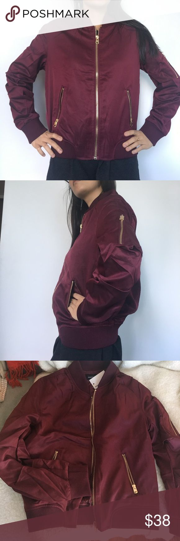 NWT burgundy sheen bomber jacket NWT burgundy sheen bomber jacket from a boutique Asian brand. Super stylish and a unique color. Gold zippers give it a nice accent. Size S though I think runs half a size small so it would look fitted on a S and fits XS as well. M will fit both sizes S and M. (Model usually wears xxs-xs) I also have one in black for size S belle and co Jackets & Coats