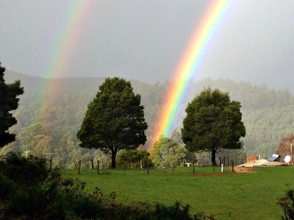 Rainbow over Lower Wilmot. Photo by Howard Smith of Cradle Coast Tours; article for think-tasmania.com