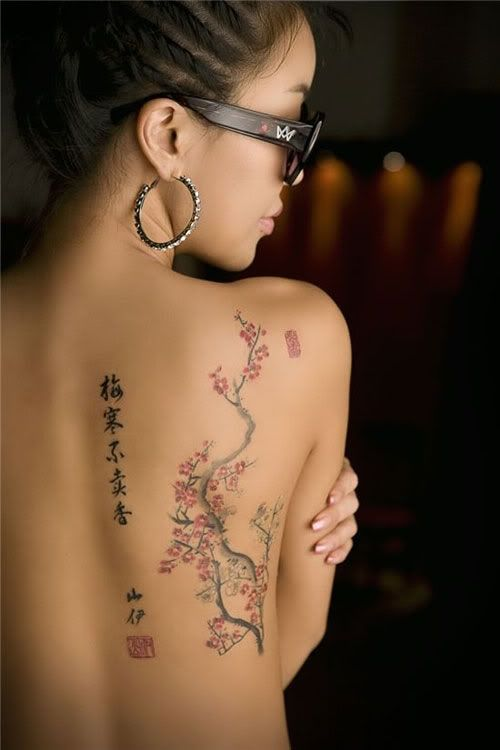 cherry blossom tattoo with text, don't know what language, down the back