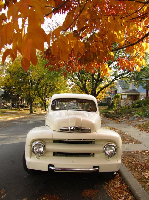 Old Creamy Ford and beautiful fall leaves.