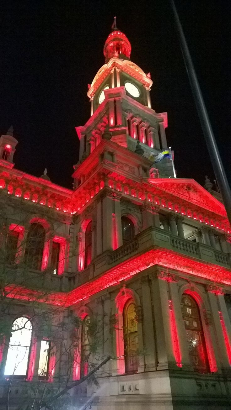 """Sydney Town Hall looking lovely in red for """"Light it Red for Dyslexia"""" on the 15th of October 2015."""