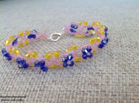 Blueyellow and pink beaweaved braceletwith swarovski by Bizoulanz