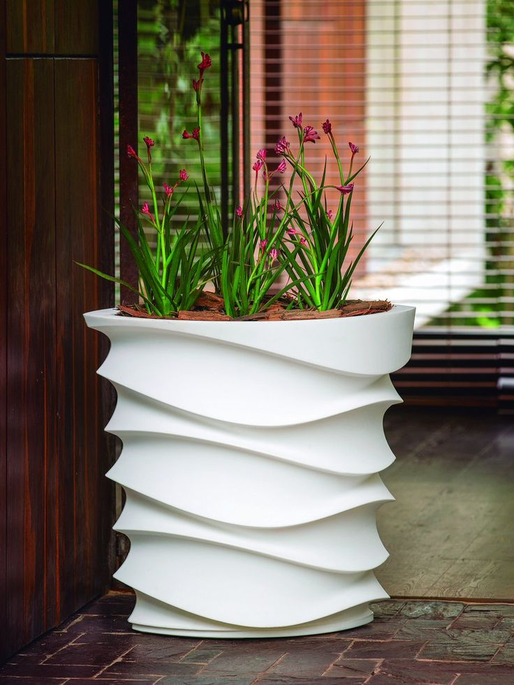 Wave hello or Wave goodbye!  These are great planters for any entrance, lobby or commercial space.  They will always catch your eye, so don't worry about the planting, even grass will do on this one.