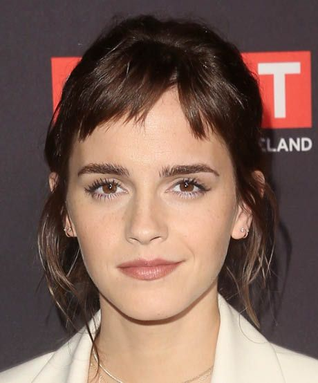 The best celebrity bangs for oval faces: Craving a bit of edge? Follow Emma Watson's lead and opt for artsy micro-bangs. They look stunning on oval faces but are also super effective in making shorter foreheads appear larger.