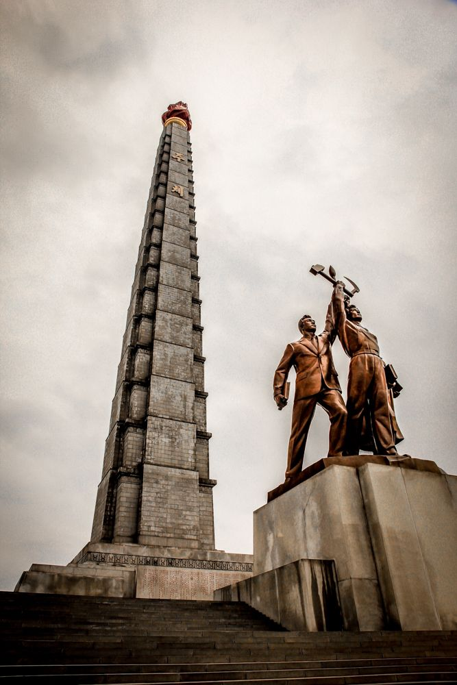 Travel tips to Visit North Korea on a budget. #Korea #NorthKorea #asia #pyongyang #travel #backpacking #statue #highway #road #countryside #JucheTower