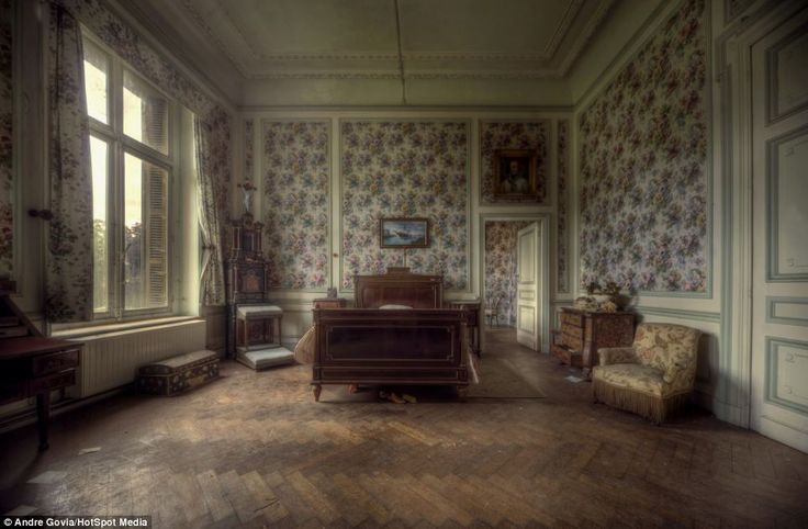 Past: The bedrooms looks like the occupants have just left, but tell-tale signs of decay and dust suggest another story. Round Mansion in Belgium was discovered and photographed by urban explorer Andre Govia. The nine bedroom mansion was abandoned sometime in the early 1990s. It appears that the tenants left in haste, because the rooms are still occupied by expensive furniture and personal effects.