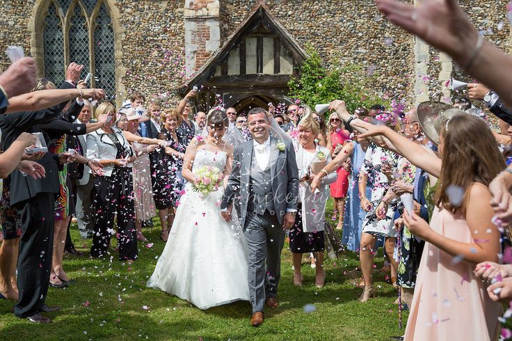 The newlyweds wander out from St Marys Church to a flurry of confetti from dear friends and family. The Church is just opposite Belchamp Hall