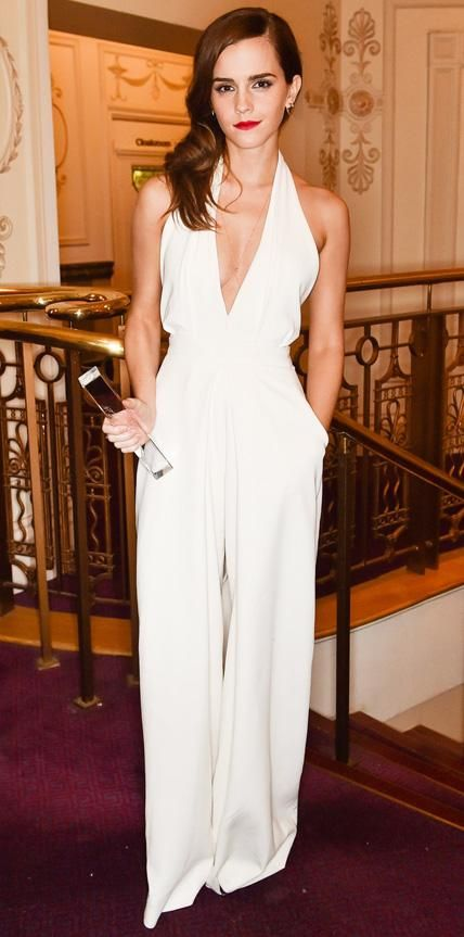 Emma Watson accepted the British Style Icon Award at the 2014 British Fashion Awards in a plunging white crepe inverted-pleat Misha Nonoo jumpsuit.
