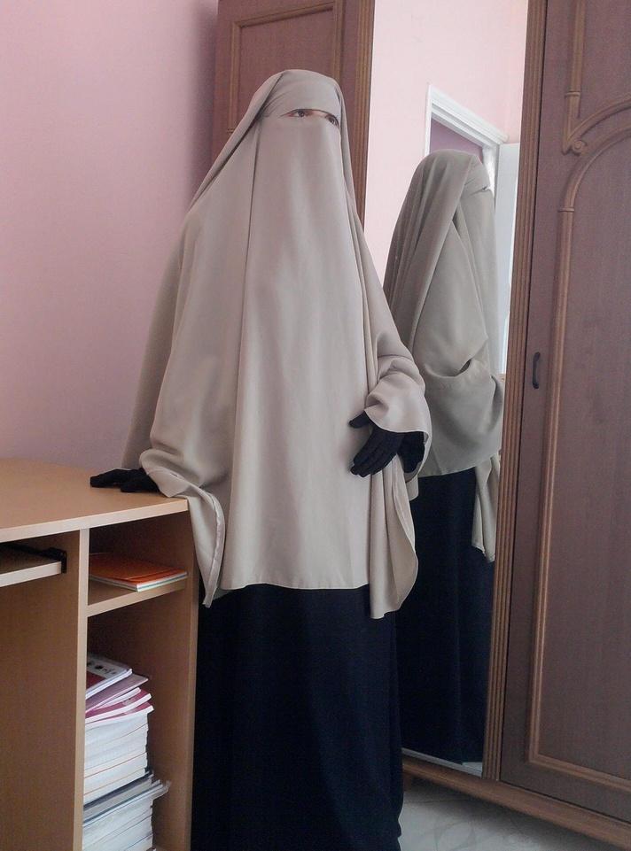 Beige niqaab + khimar. Worn over dark blue abaya and matching gloves