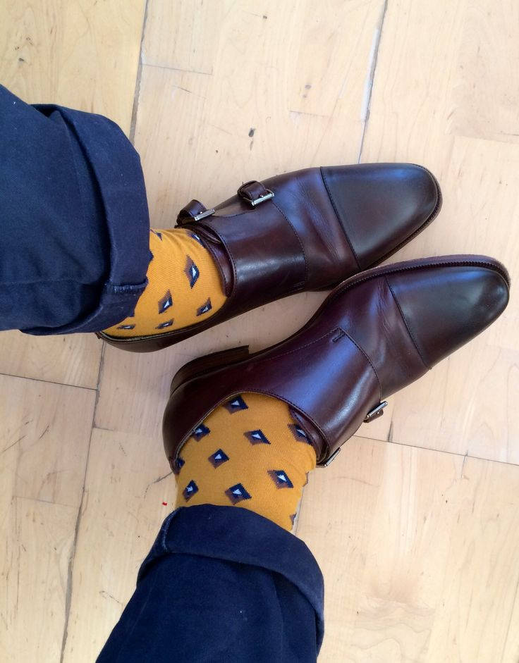 Casual work-wear: navy chinos, mustard socks from SuitSupply and brown monkstraps from Reiss. Men's fashion, shoes.