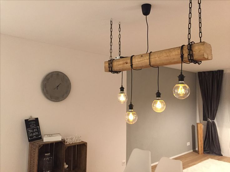 Selfmade Rustic Lamp With Hanging Light Bulbs And Wooden Beams