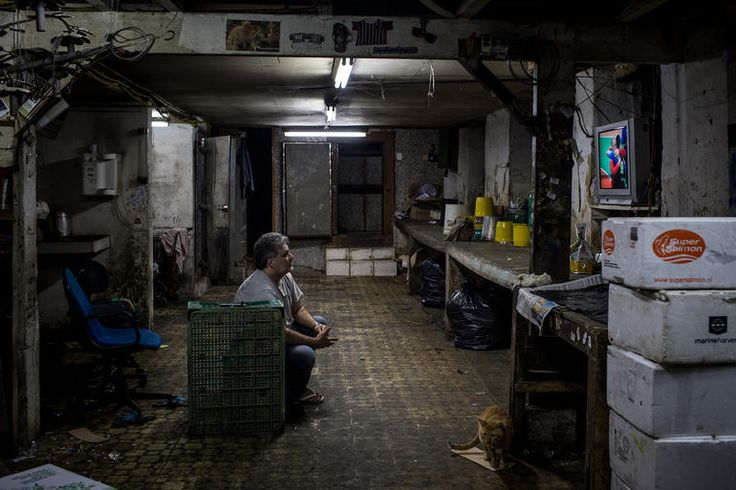 A man watches the Olympic games on his tv in the basement of a shop on Aug. 15, 2016 in Rio de Janeiro, Brazil. Brazil is currently hosting the 2016 Summer Olympic games despite the dismissal of President Dilma Rousseff, pollution concerns, ongoing crime problems and a failing economy. Around 1.4 million residents, or approximately 22 percent of Rio's population, reside in favelas which often lack proper sanitation, health care, education and security, for many of these residents watching…
