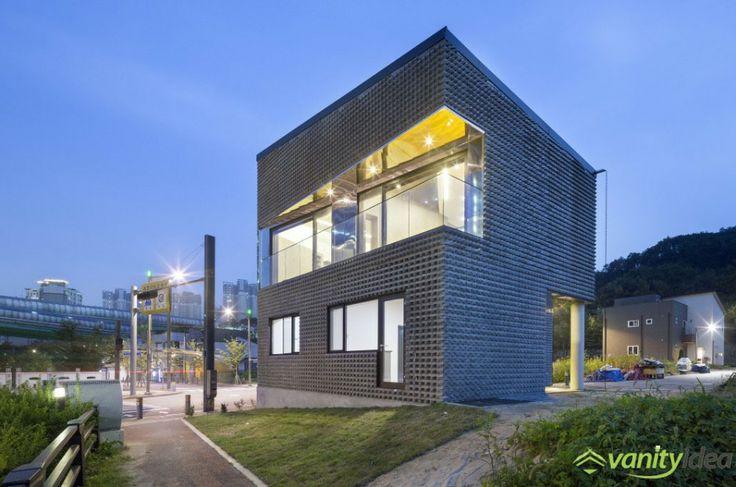 basalt-brick house with big windoes