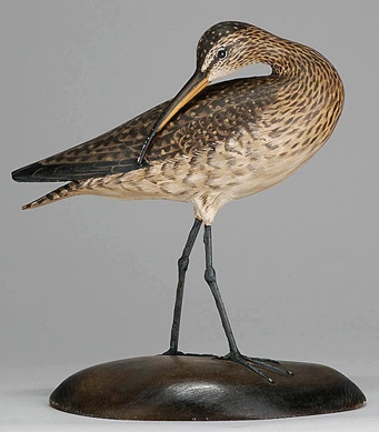 A life-size decorative preening curlew by A. Elmer Crowell sold for $35,400.