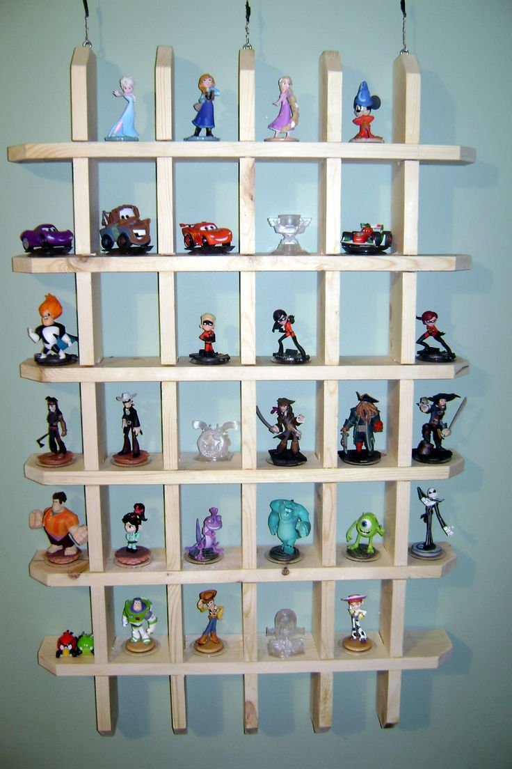 Cubby hole shelving made out of 1x4's to hold all my sons Disney Infinity characters and more/