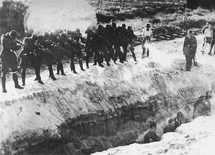 holocaust pictures | Members of an Einsatzkommando firing at men standing at the bottom of ...