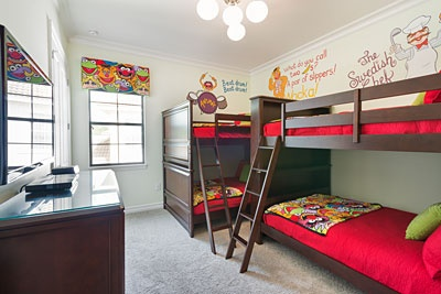 "Kids can sleep in this fun ""Muppets""-themed bedroom featuring some of their favorite characters like Gonzo, Swedish Chef, Fozzie Bear and Animal."