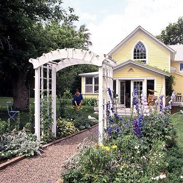 Put an arbor -- even a simple one -- over your front walk to dress up your front yard and make your entrance a memorable one. For the most impact, choose an arbor that fits with the style and scale of your home.