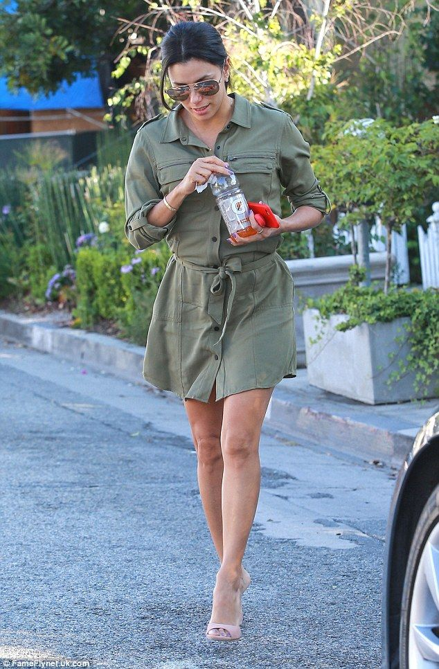 Perfect fit: Eva Longoria wore a buttoned shirt dress perfectly as she stepped out in Beverly Hills on Tuesday