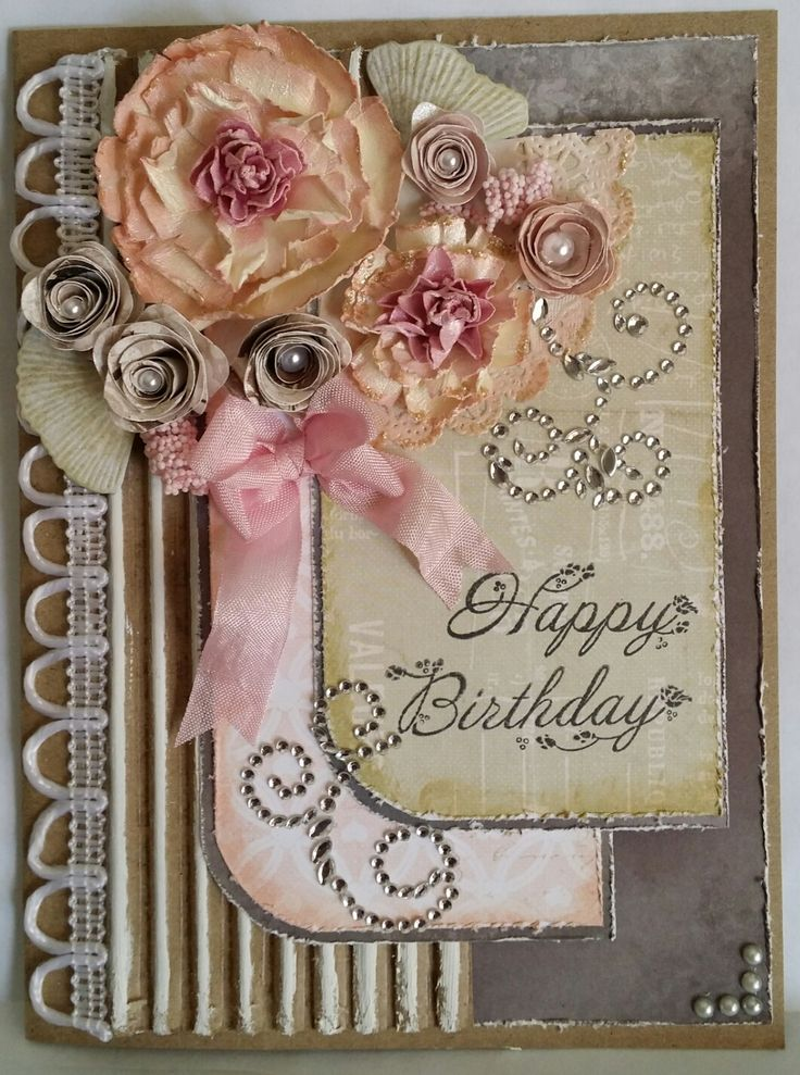 Challenge 3 - 2015 - Handmade flowers - Two big flowers are punched, distressed, wet and crumpled, then put together once dry. Five smaller flowers are diecuts with a pearl centre. Cardboard painted with craft paint, crystal, ribbon and lace embellishments.