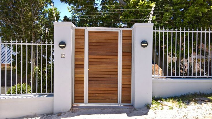 Galvanized mild steel and painted gate cladded with Ipe Wood.