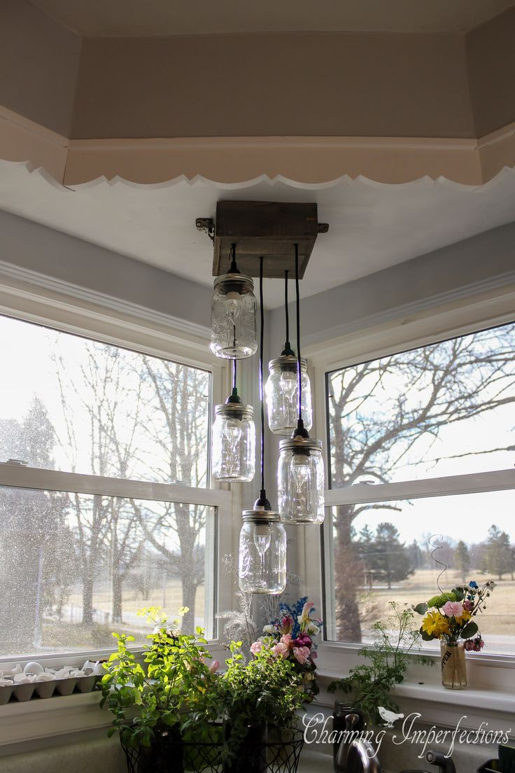 Lovely DIY Mason Jar Chandelier. Click For The Full Tutorial