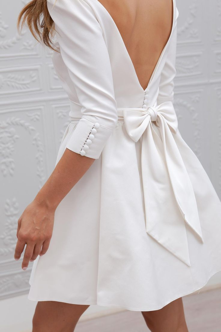 Gorgeous 3/4 length, tea-cup white dress with a low back. Perfect for rehearsal!