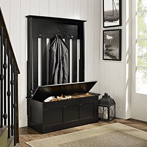 Rich dark woods contrast with the bead board walls. A traditional hall tree is combined with a storage bench for an all-in-one solution to a small or non-existent closet.