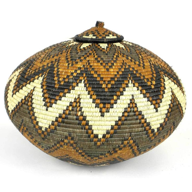 Fair Trade Handmade Zulu Wedding Basket -OS-06 - Ilala Weavers - The Village Country Store   Traditionally woven to store beer, these baskets are handwoven in South Africa and often give as wedding gift. This basket with a tight-fitting lid is adorn with the traditional Zulu design in natural dyes. 15 inches tall x 19 inches wide x 19 inches deep