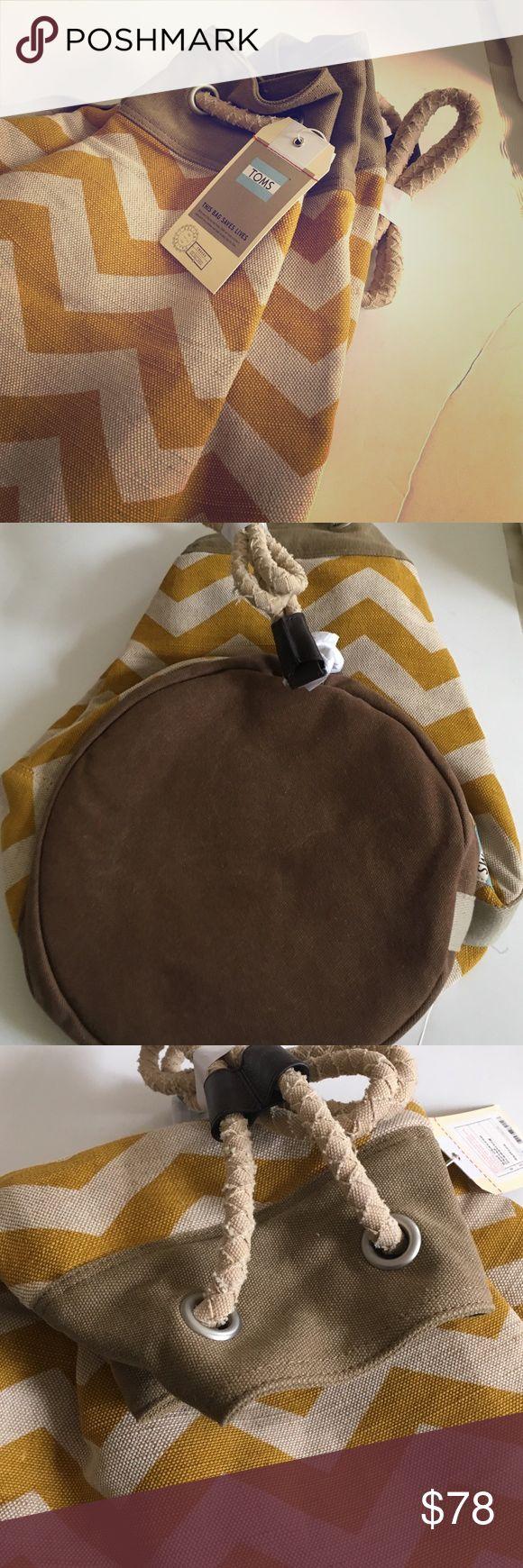 Toms Drawstring Bag Adorable drawstring bag in saffron Chevron TOMS Bags