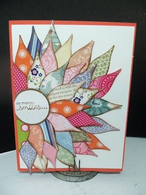 """By Sharon. Used Stampin' Up's Blossom Petal Punch on scraps of designer paper. Sponged edges of punched shapes with soft suede. Stamped sentiment on 1 1/4"""" circle matted on 1 3/8"""" soft suede circle. Glued middle of circle to card base, then started attaching petals."""