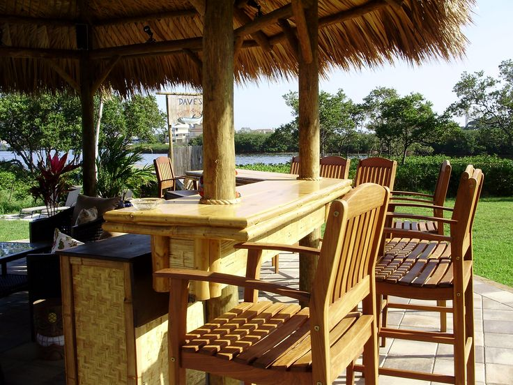 20' permanent tiki hut gazebo style with a palm thatch roof and a heavy weave bamboo bar countertop   constructed in Tarpon Springs florida for the DIY Network show Indoors Out