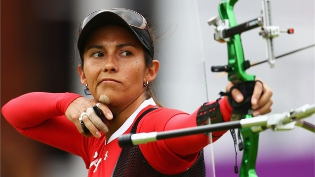 Denisse van Lamoen of Chile competes in her women's individual Archery 1/32 eliminations match against Kristine Esebua of Georgia during Day 4 of the London 2012 Olympic Games at Lord's Cricket Ground.