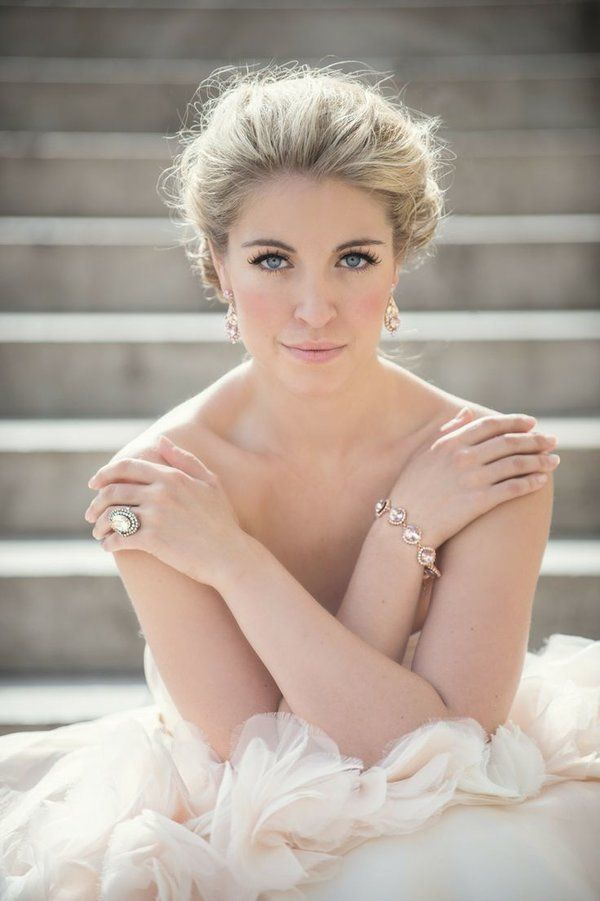 Natural bride in ruffled dress and pulled back hair and simple jewelry.