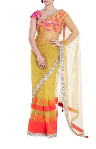 VIKRAM PHADNIS Trendy yellow net saree with amber, raw silk borders and gold sequin and diamond detailing.  #Saree #fashion #Bollywoodfashion #silksaree