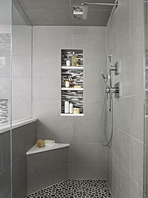 Tuck One In Look to a walk-in shower corner for a spot to place a shower seat. Though its form is tiny, this corner bench provides a good deal of utility in a midsize walk-in shower. Adding a white seat to the gray-tiled base lets the bench show up against walls gray-tile walls. The white seat also ties the bench to the mosaic-tile niches and river-rock-tile floor.