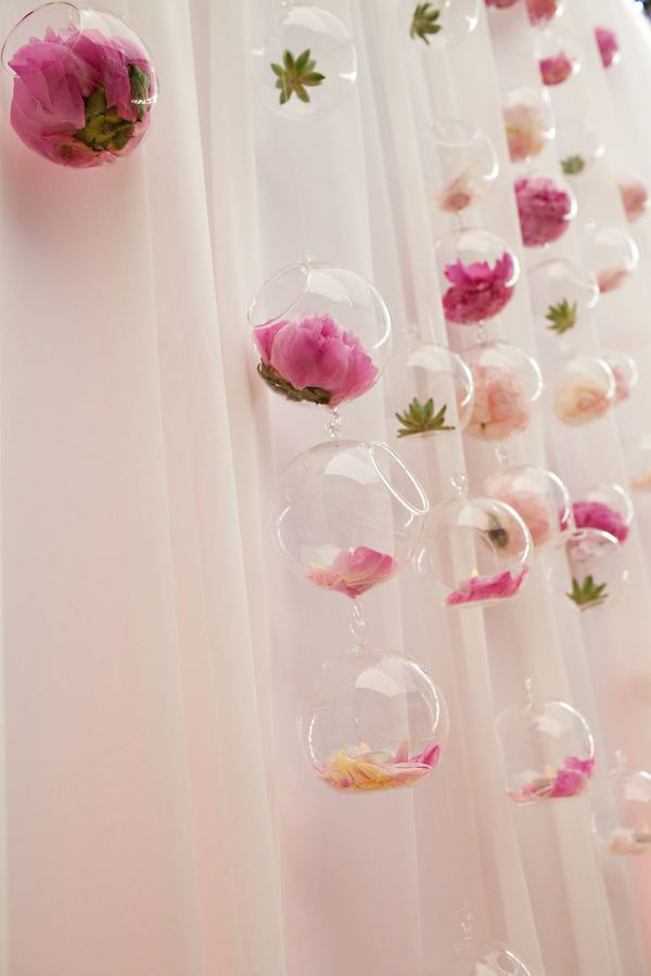 hanging flowers in glass bowls. love it!