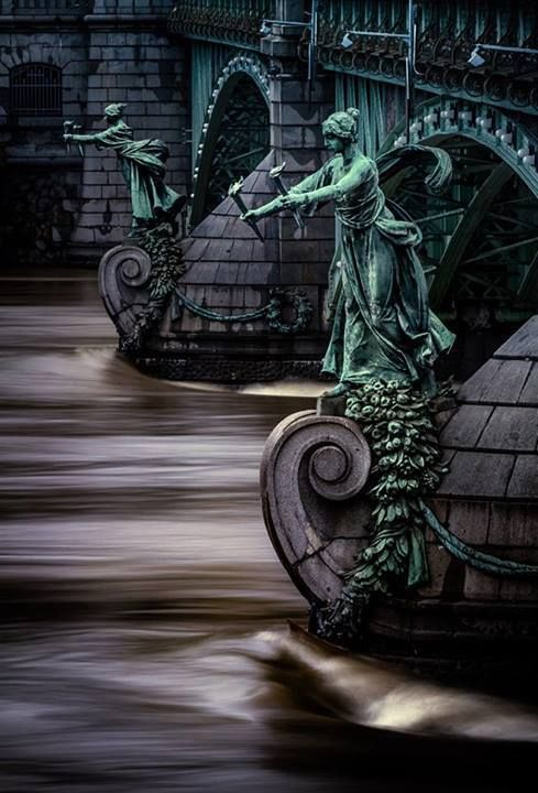 Torchbearers on the pillars of the bridge of Svatopluk Čech, Prague, Czechia