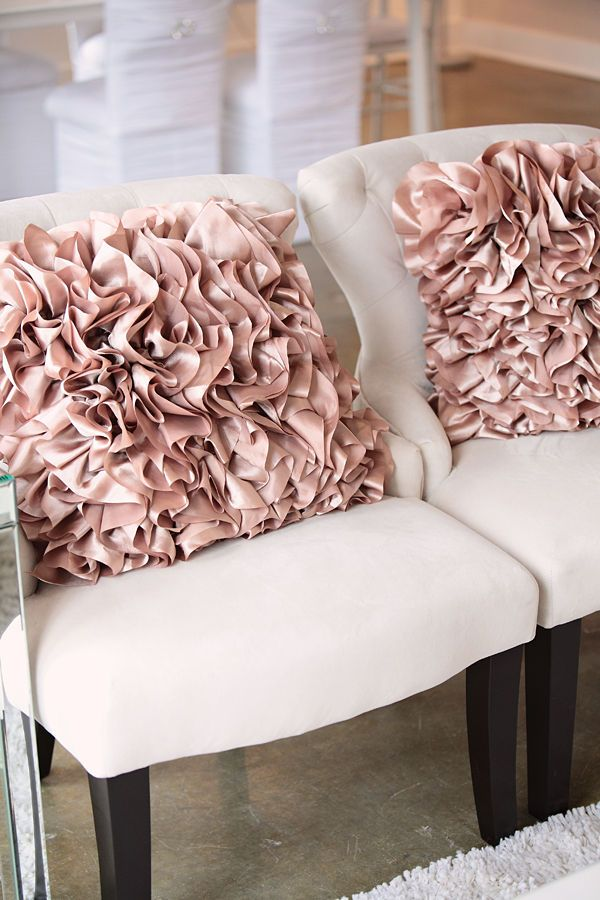 Off-white chairs with a splash of rose pink creates instant luxury.